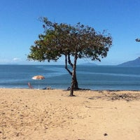 Photo taken at Praia Martim de Sá by Diego F. on 7/28/2013