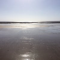 Photo taken at Swansea Bay Beach by Patricia A. on 3/7/2015