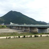 Photo taken at 野洲川大橋 by T K. on 10/8/2012