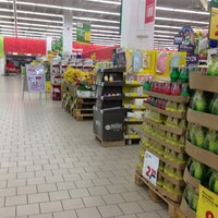 Photo taken at Auchan by Adam G. on 3/26/2013