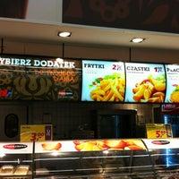 Photo taken at Auchan by Adam G. on 12/29/2012