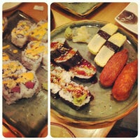 Photo taken at Momo Sushi & Cafe by Luke S. on 11/30/2012