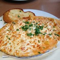 Photo taken at Boston Pizza by Cinthia D. on 6/1/2013