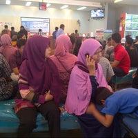 Photo taken at Bank BNI Cabang Jombang by Vita N. on 8/5/2013