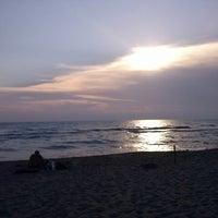 Photo taken at Mama/Dune Beach by Eva B. on 7/24/2013
