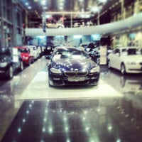 Photo taken at BMW АВТОDOM by Александр А. on 12/14/2012