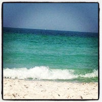 Photo taken at Coquina Beach by Melissah B. on 3/31/2013