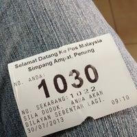 Photo taken at Pejabat Pos (Post Office) by Julia M. on 7/30/2013