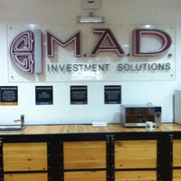 Photo taken at M.A.D Investment Solutions by СААРАЛ ( Grey ) on 10/16/2013