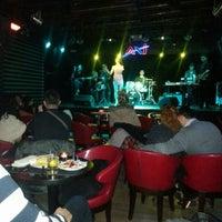 Photo taken at Axi Bar by Yaşar Y. on 1/6/2013