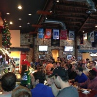 Photo taken at Home Team Grill by Eric R. on 12/9/2012