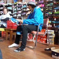 Photo taken at Movin' Shoes by Andrew H. on 3/15/2014