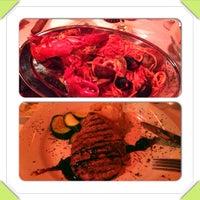 Photo taken at Argentango Steakhouse by Aleksandra S. on 10/6/2013