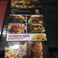 Photo taken at Red Robin Gourmet Burgers by Brian L. on 2/5/2017