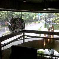 Photo taken at Starbucks Coffee by Chel J. on 12/26/2012
