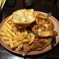 Photo taken at Nando's by Emanuel A. on 4/6/2013