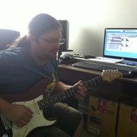 Photo taken at Power Trip Instituto de Guitarra by Thiago J. on 1/4/2013