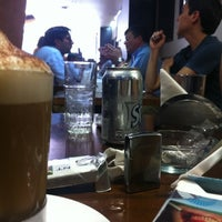 Photo taken at Aromas Café by Jai M. on 11/15/2012