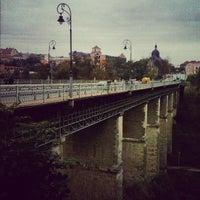 Photo taken at Мост для прыжков над р. Смотрич by Евген К. on 10/13/2012