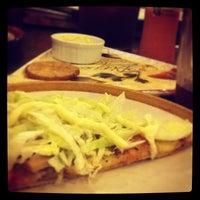 Photo taken at Handuraw Pizza by Mike Matthew Ian C. on 2/21/2014