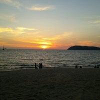 Photo taken at Pantai Cenang (Beach) by Min A. on 3/24/2013