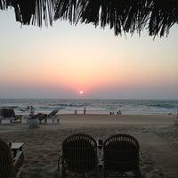 Photo taken at Candolim Beach by Tatiana B. on 2/23/2013