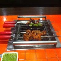 Photo taken at Sigree Global Grill by Murtuza k. on 10/6/2013