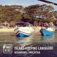 Photo taken at Pantai Cenang (Beach) by Aishah S. on 2/22/2013