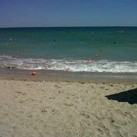 Photo taken at Plaja Neptun by Ioana M. on 8/4/2013
