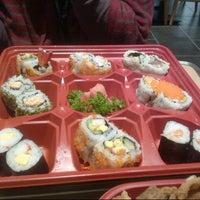 Photo taken at Sushi Kiosk by desy a. on 3/8/2013