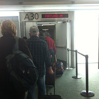 Photo taken at Gate A30 by Justin M. on 11/28/2012