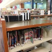 Photo taken at Northwest regional library by Crystal V. on 6/25/2013