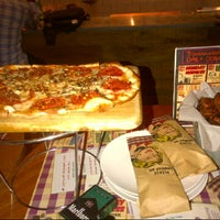 Photo taken at Pizza é Birra by Tika L. on 10/19/2012