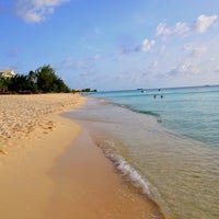 Photo taken at Seven Mile Beach, Harbour Heights by EJ B. on 8/18/2014