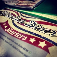 Photo taken at Woodies Longboard Diner by Forbes C. on 2/9/2014