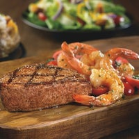 Photo taken at Outback Steakhouse by OSI Restaurant Partners, LLC M. on 5/30/2015