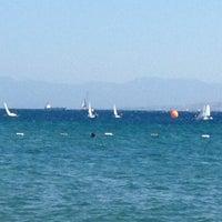 Photo taken at Hayat Bana Güzel Beach by Elif U. on 9/4/2012