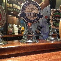 Photo taken at The Greyhound  (Wetherspoon) by Chris T. on 7/9/2013