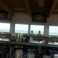 Photo taken at Sunset Beach Bar by Stephen L. on 4/30/2013