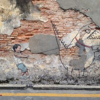 Photo taken at Penang Street Art : Little Boy with Pet Dinosaur by Alison Y. on 11/30/2016