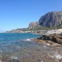 Photo taken at Addaura Beach by Adelya V. on 8/10/2014