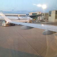 Photo taken at Gate 14 by Luca C. on 8/16/2014