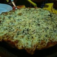 Photo taken at Gato Gordo Bar. Pizza. Parrilla by Augusto L. on 2/13/2013