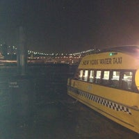 Photo taken at East River Esplanade by Ivana B. on 12/4/2012