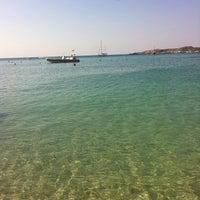 Photo taken at Vouliagmeni Beach by Natasa P. on 8/18/2013