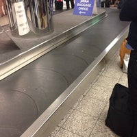 Photo taken at Baggage Claim by Alex T. on 12/11/2013