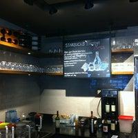 Photo taken at Starbucks by Alex T. on 10/20/2012
