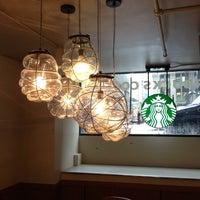 Photo taken at Starbucks by Alex T. on 5/9/2013