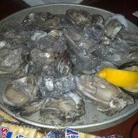 Photo taken at Sharky's Beachfront Restaurant by Pamela H. on 12/15/2012
