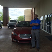 Photo taken at Land Rover Jacksonville by Corinna H. on 3/25/2014